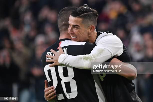Juventus' Portuguese forward Cristiano Ronaldo celebrates with Juventus' Turkish defender Merih Demiral after Juventus scored during the Italian...