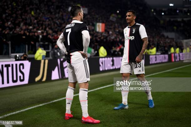 Juventus' Portuguese forward Cristiano Ronaldo celebrates with Juventus' Brazilian defender Danilo after opening the scoring during the Italian Cup...