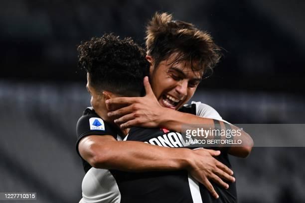 Juventus' Portuguese forward Cristiano Ronaldo celebrates with Juventus' Argentine forward Paulo Dybala after scoring a goal during the Italian Serie...