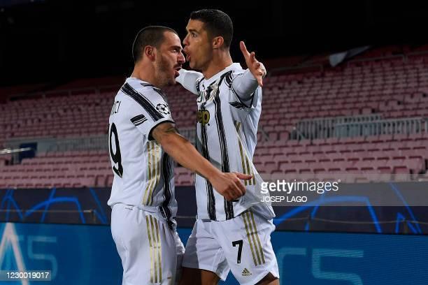 Juventus' Portuguese forward Cristiano Ronaldo celebrates with Juventus' Italian defender Leonardo Bonucci after scoring a goal during the UEFA...