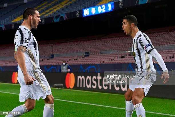 Juventus' Portuguese forward Cristiano Ronaldo celebrates with Juventus' Italian defender Leonardo Bonucci after scoring his team's third goal during...