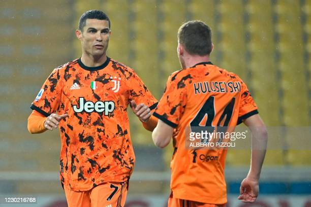 Juventus' Portuguese forward Cristiano Ronaldo celebrates with Juventus' Swedish forward Dejan Kulusevski after scoring during the Italian Serie A...