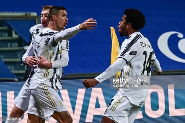 Juventus' Portuguese forward Cristiano Ronaldo celebrates with Juventus' Swedish forward Dejan Kulusevski and Juventus' American midfielder Weston...