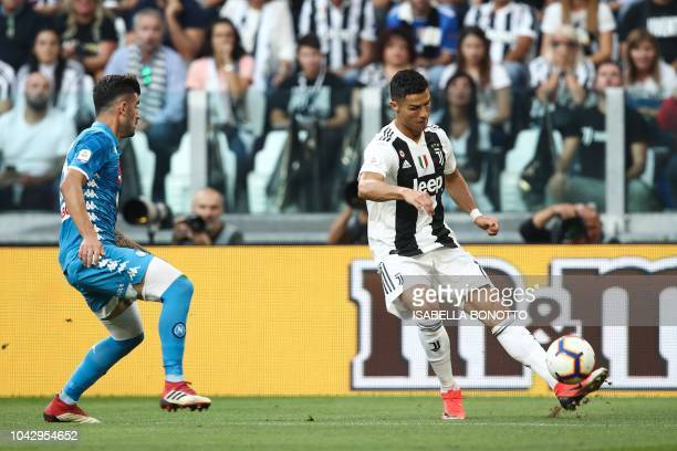 Juventus' Portuguese forward Cristiano Ronaldo centres the ball for Juventus to equalize during the Italian Serie A football match Juventus vs Napoli...