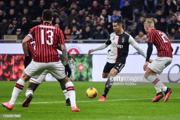 Juventus' Portuguese forward Cristiano Ronaldo challenges AC Milan's Danish defender Simon Kjaer during the Italian Cup semifinal first leg football...