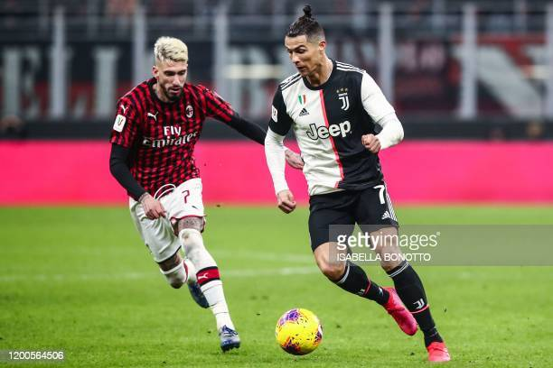 Juventus' Portuguese forward Cristiano Ronaldo challenges AC Milan's Spanish forward Samu Castillejo during the Italian Cup semifinal first leg...