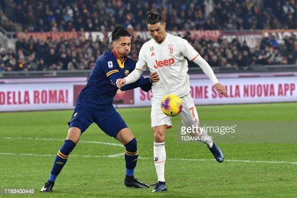 Juventus' Portuguese forward Cristiano Ronaldo challenges AS Roma's English defender Chris Smalling during the Italian Serie A football match AS Roma...
