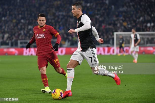 Juventus' Portuguese forward Cristiano Ronaldo challenges AS Roma's Turkish forward Cengiz Under during the Italian Cup round of 8 football match...
