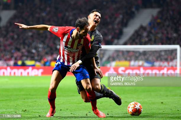 Juventus' Portuguese forward Cristiano Ronaldo challenges Atletico Madrid's Spanish defender Juanfran during the UEFA Champions League round of 16...