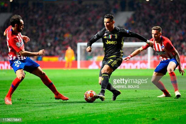 Juventus' Portuguese forward Cristiano Ronaldo challenges Atletico Madrid's Spanish defender Juanfran and Atletico Madrid's Spanish midfielder Saul...
