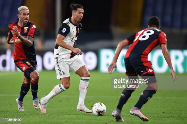 Juventus' Portuguese forward Cristiano Ronaldo challenges Genoa's Italian defender Paolo Ghiglione during the Italian Serie A football match Genoa vs...