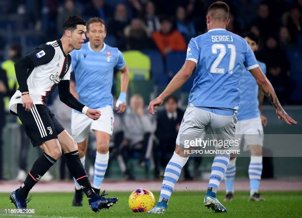 Juventus' Portuguese forward Cristiano Ronaldo challenges Lazio's Serbian midfielder Sergej MilinkovicSavic during the Italian Serie A football match...