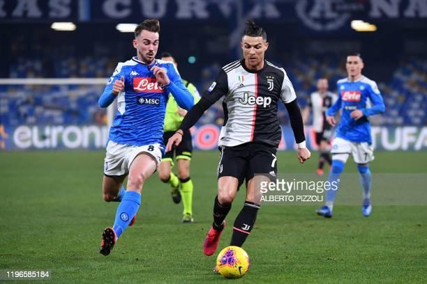 Juventus' Portuguese forward Cristiano Ronaldo challenges Napoli's Spanish defender Fabian Ruiz during the Italian Serie A football match Napoli vs...