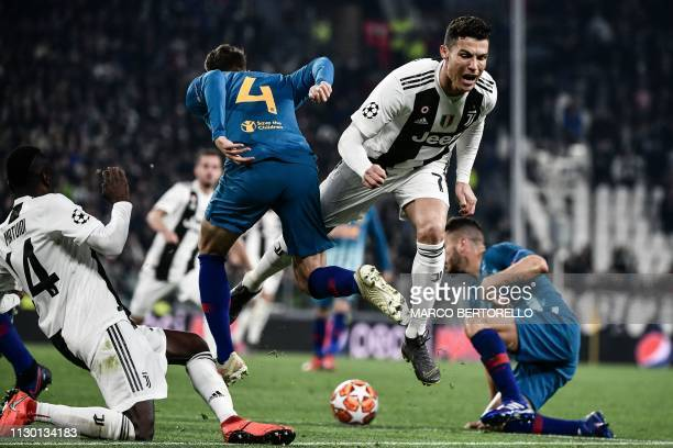 Juventus' Portuguese forward Cristiano Ronaldo collides with Atletico Madrid's Colombian defender Santiago Arias during the UEFA Champions League...