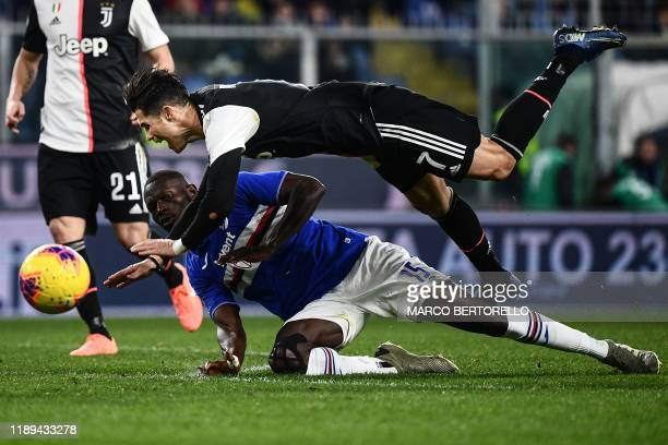 Juventus' Portuguese forward Cristiano Ronaldo collides with Sampdoria's Gambian defender Omar Colley during the Italian Serie A football match...