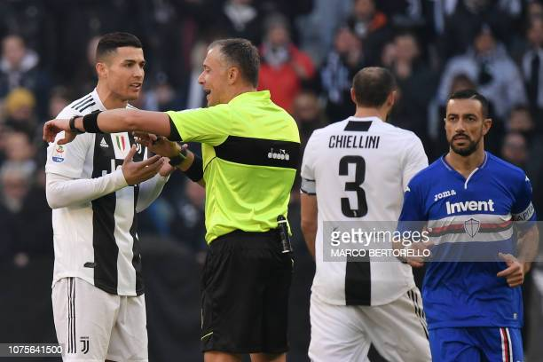 Juventus' Portuguese forward Cristiano Ronaldo complains to Italian referee Paolo Valeri after he granted a penalty kick scored by Sampdoria's...