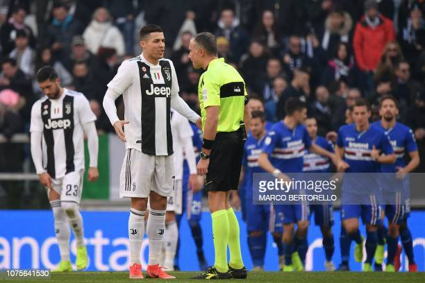 Juventus' Portuguese forward Cristiano Ronaldo complains to Italian referee Paolo Valeri after he granted a penalty to Sampdoria during the Italian...