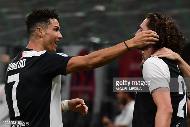 Juventus' Portuguese forward Cristiano Ronaldo congratulates Juventus' French midfielder Adrien Rabiot after Rabiot opened the scoring during the...