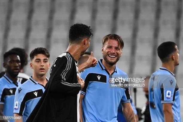 Juventus' Portuguese forward Cristiano Ronaldo congratulates Lazio's Italian forward Ciro Immobile at the end of the Italian Serie A football match...