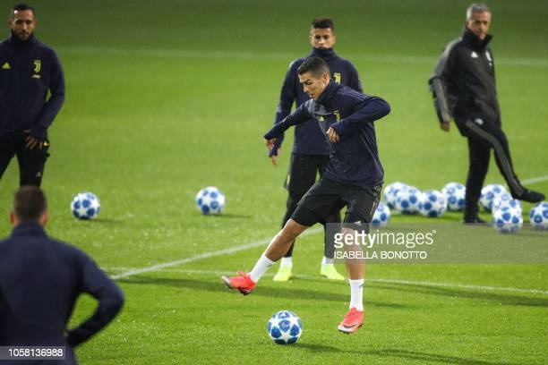 Juventus' Portuguese forward Cristiano Ronaldo controls a ball during a training session at the Contassina training ground in Turin on November 6...