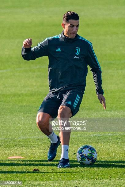 Juventus' Portuguese forward Cristiano Ronaldo controls the ball during a training session on November 5, 2019 at the Juventus Training Center in...
