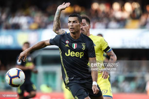 Juventus' Portuguese forward Cristiano Ronaldo controls the ball during the Italian Serie A football match AC Chievo vs Juventus at the...