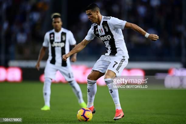 Juventus' Portuguese forward Cristiano Ronaldo controls the ball during the Italian Serie A football match Empoli vs Juventus on October 27, 2018 at...