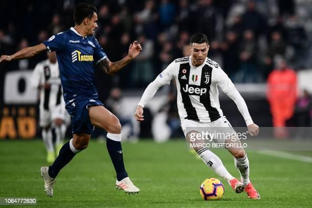 Juventus' Portuguese forward Cristiano Ronaldo controls the ball during the Italian Serie A football match Juventus vs Spal 2013 on November 24 2018...