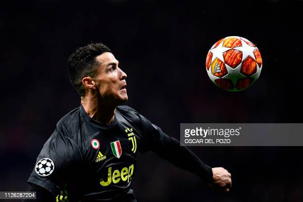 TOPSHOT Juventus' Portuguese forward Cristiano Ronaldo controls the ball during the UEFA Champions League round of 16 first leg football match...