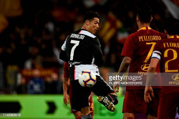 Juventus' Portuguese forward Cristiano Ronaldo controls the ball during the Italian Serie A football match between AS Roma and Juventus Turin at the...