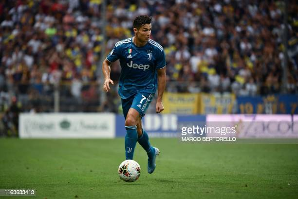 Juventus' Portuguese forward Cristiano Ronaldo controls the ball during the Italian Serie A football match Parma vs Juventus on August 24 2019 at the...