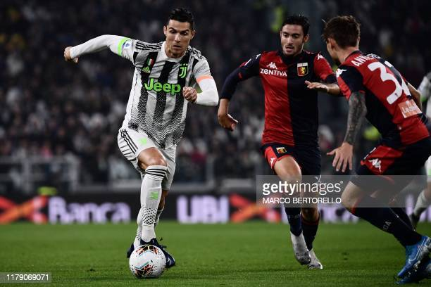 Juventus' Portuguese forward Cristiano Ronaldo controls the ball during the Italian Serie A football match between Juventus and Genoa on October 30...