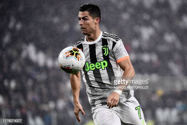 TOPSHOT Juventus' Portuguese forward Cristiano Ronaldo controls the ball during the Italian Serie A football match between Juventus and Genoa on...