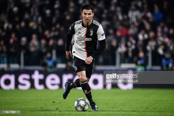 Juventus' Portuguese forward Cristiano Ronaldo controls the ball during the UEFA Champions League Group D football match Juventus Turin vs Atletico...