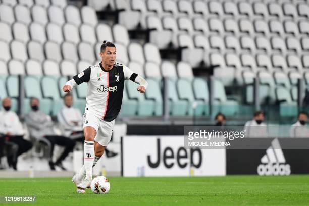 Juventus' Portuguese forward Cristiano Ronaldo controls the ball during the Italian Cup semi-final second leg football match Juventus vs AC Milan on...