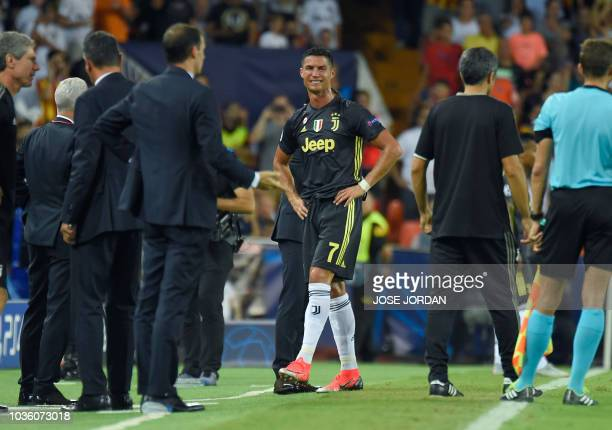 TOPSHOT Juventus' Portuguese forward Cristiano Ronaldo cries after receiving a red card during the UEFA Champions League group H football match...