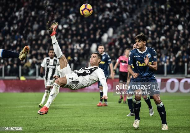 Juventus' Portuguese forward Cristiano Ronaldo does an overhead kick during the Italian Serie A football match Juventus vs Spal 2013 on November 24...