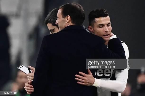 Juventus' Portuguese forward Cristiano Ronaldo embraces Juventus' Italian coach Massimiliano Allegri after being substituted during the Italian Serie...