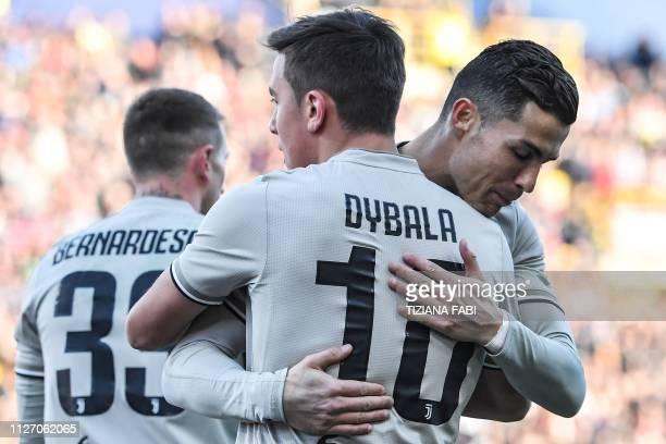 Juventus' Portuguese forward Cristiano Ronaldo embraces Juventus' Argentine forward Paulo Dybala after Dybala opened the scoring during the Italian...