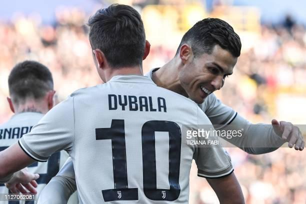 Juventus' Portuguese forward Cristiano Ronaldo embraces Juventus' Argentine forward Paulo Dybala after Dybala opened the scoring during the Italian...