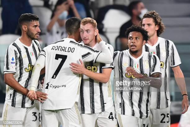 Juventus' Portuguese forward Cristiano Ronaldo embraces Juventus' Swedish forward Dejan Kulusevski after Kulusevski opened the scoring during the...