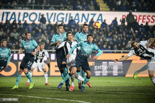 Juventus' Portuguese forward Cristiano Ronaldo eyes the ball being centred during the Italian Serie A football Match Atalanta Bergamo vs Juventus on...