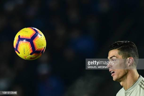 Juventus' Portuguese forward Cristiano Ronaldo eyes the ball during the Italian Tim Cup round of eight football match Atalanta Bergamo vs Juventus on...