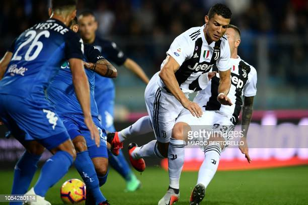 Juventus' Portuguese forward Cristiano Ronaldo falls during the Italian Serie A football match Empoli vs Juventus on October 27 2018 at the Carlo...