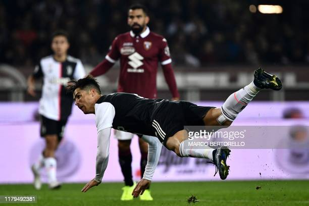 Juventus' Portuguese forward Cristiano Ronaldo falls during the Italian Serie A football match Torino vs Juventus on November 2 2019 at the 'Stadio...