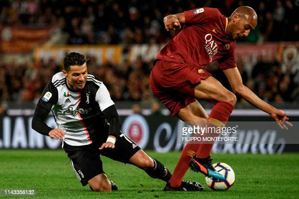 Juventus' Portuguese forward Cristiano Ronaldo fights for the ball with AS Roma French midfielder Steven Nzonzi during the Italian Serie A football...