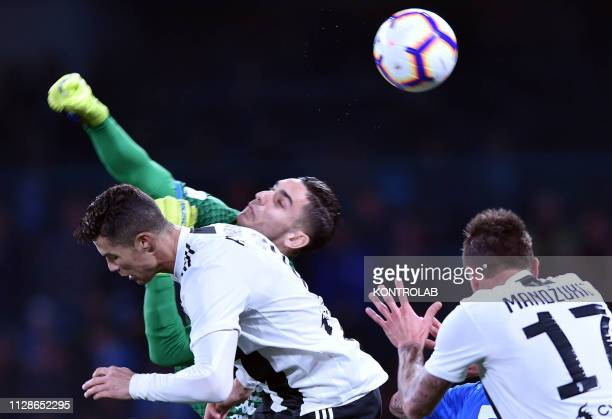 STADIUM NAPLES CAMPANIA ITALY Juventus' Portuguese forward Cristiano Ronaldo fights for the ball with Napoli's Italian goalkeeper Alex Meret during...