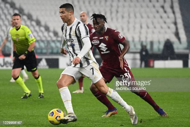 Juventus' Portuguese forward Cristiano Ronaldo fights for the ball with Torino's French midfielder Souahilo Meite during the Italian Serie A football...