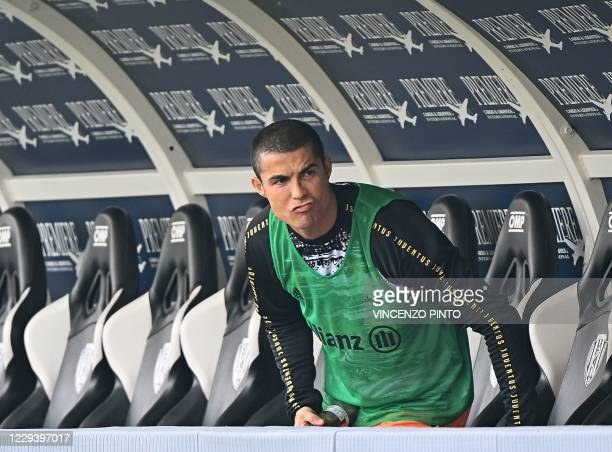Juventus' Portuguese forward Cristiano Ronaldo gestures as he arrives to sit on the bench prior to the start of the Italian Serie A football match...