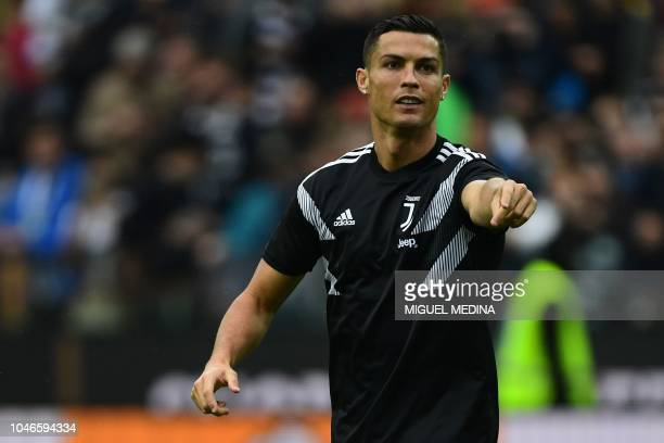 TOPSHOT Juventus' Portuguese forward Cristiano Ronaldo gestures as he warms up before the Italian Serie A football match Udinese Calcio vs Juventus...